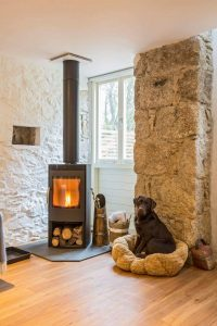 Keeping Warm by the Wood burner at Red River Cottages, Reskadinnick